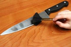 Huellas digitales en el cuchillo Imagenes de archivo