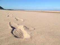 Huellas en la arena Foto de archivo
