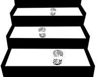 Huellas en las escaleras; las casillas negras se pueden utilizar para el texto Foto de archivo libre de regalías