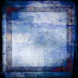 Hues of blues grunge background. A grunge style background in different hues of blue and brown, for scrapbooks or photo album pages Royalty Free Stock Images