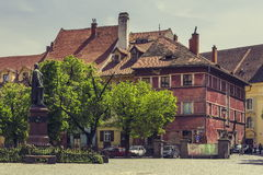 The Huet Square, Sibiu, Romania. Sibiu, Romania - 06 May, 2015: Huet Square, one of the three beautiful squares in the historical center of the Upper Town of Royalty Free Stock Photo