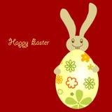 Huevo de Pascua con el conejito lindo de la sonrisa Fotografía de archivo