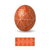 Huevo de Pascua con el ornamento Imagenes de archivo