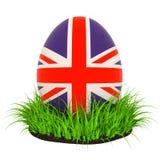 Huevo de Pascua con la bandera del Reino Unido en la hierba verde, representación 3D stock de ilustración