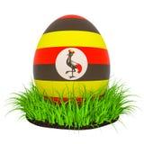 Huevo de Pascua con la bandera de Uganda en la hierba verde, representación 3D ilustración del vector