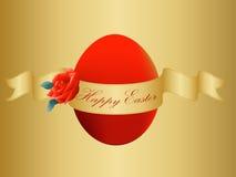 Huevo de Pascua del oro con la cinta y el texto Foto de archivo libre de regalías