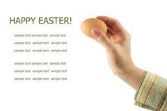 Huevo de Pascua en una mano femenina Fotografía de archivo libre de regalías