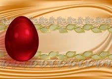 Huevo de Pascua rojo en un backdround de un cordón Imagen de archivo
