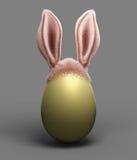 Huevo del día de fiesta de Pascua con los oídos del conejito de pascua