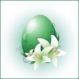Huevo del símbolo de Pascua con los lirios Fotos de archivo libres de regalías