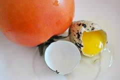 Huevo del tomate y de codornices Imagen de archivo