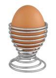 Huevo en el sostenedor aislado en blanco Fotografía de archivo