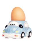 Huevo en huevera del coche Fotografía de archivo