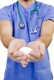 Huevo en un doctor de la mano Imágenes de archivo libres de regalías