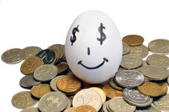 Huevo y dinero Imagen de archivo libre de regalías