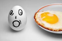 Huevo y miedo imagenes de archivo