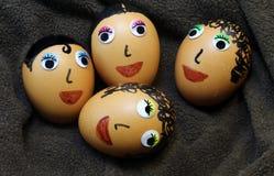 Huevos adornados con los ojos y el pelo Foto de archivo libre de regalías