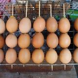 Huevos asados a la parilla en el shell Imágenes de archivo libres de regalías