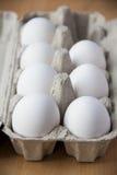 Huevos blancos en rectángulo Imágenes de archivo libres de regalías