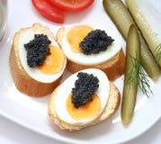 Huevos con el caviar Imágenes de archivo libres de regalías