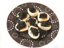 Huevos con el caviar Fotografía de archivo libre de regalías