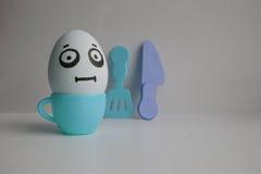 Huevos con la cara Concepto de desayuno temprano Foto de archivo libre de regalías