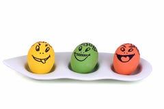 Huevos con la cara de la historieta Fotografía de archivo
