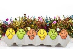 Huevos con la cara de la historieta Foto de archivo