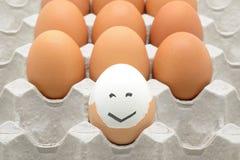 Huevos con la cara feliz fotografía de archivo libre de regalías