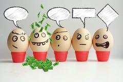 Huevos con la cara pintada Concepto Foto de archivo
