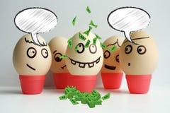 Huevos con la cara pintada Equipo del concepto Fotografía de archivo