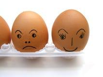 Huevos con las caras Imágenes de archivo libres de regalías