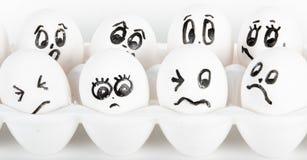 Huevos con las caras Fotos de archivo