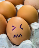 Huevos con las caras Foto de archivo libre de regalías