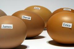 Huevos con nombres Fotos de archivo libres de regalías