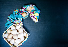 Huevos crudos en el fondo azul Imágenes de archivo libres de regalías
