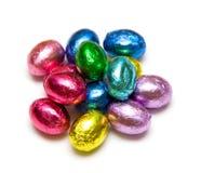 Huevos de chocolate en embalaje flexible Imágenes de archivo libres de regalías