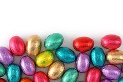 Huevos de chocolate en hoja Imagen de archivo libre de regalías