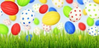 Huevos de Cololrful Pascua que caen en la hierba verde Fotos de archivo