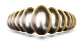 Huevos de oro para Pascua en el fondo blanco Fotografía de archivo