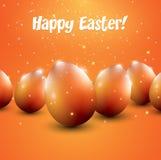 Huevos de Pascua anaranjados en fondo anaranjado Imagen de archivo libre de regalías