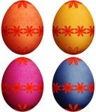 Huevos de Pascua anaranjados, púrpuras, azules y amarillos festivos Fotografía de archivo libre de regalías