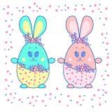 Huevos de Pascua bajo la forma de liebres Muchacho y muchacha libre illustration