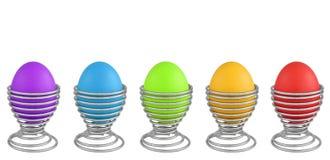 Huevos de Pascua coloridos aislados en blanco Fotografía de archivo libre de regalías