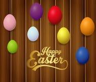 Huevos de Pascua coloridos con poner letras a Pascua feliz en fondo de madera marrón libre illustration