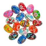 Huevos de Pascua coloridos en blanco Fotos de archivo libres de regalías