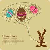 Huevos de Pascua con el conejito lindo de la historieta Imagenes de archivo