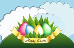 Huevos de Pascua con la hierba y la cinta Imágenes de archivo libres de regalías