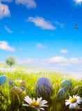 Huevos de Pascua del arte en campo de la primavera Imagen de archivo libre de regalías
