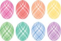 Huevos de Pascua en colores pastel de la tela escocesa Imagenes de archivo